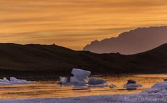 Orange (Snia CM) Tags: sunset sky orange naturaleza ice nature water canon landscape iceland islandia iceberg jokulsarlon waterscape 6d canon6d jokulsrln