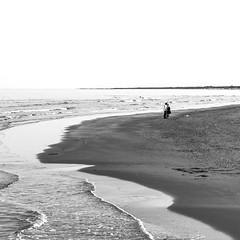 A kiss (maxlaurenzi) Tags: sea italy woman white man black love beach nature water walking spring sand kiss couple waves mood alone atmosphere romance porto shore ferrara garibaldi
