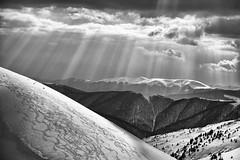 Rays of evening sun. (kirilko) Tags: bw mountains ukraine sunrays dramaticsky carpathians canoneos5d downhillskiing dragobrat ef24105mmf4lisusm