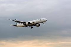 Pakistan International Airlines (HotSnapshot) Tags: pakistan sunset sky cloud london clouds canon cloudy heathrow telephoto pakistani canon5d boeing 75300mm pia terminal5 londonheathrow canon75300mm pakistaninternationalairlines londonbylondoners londonatsunset boeing777340 canon5dmarkiii 777340 canon5dmark3