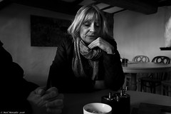 Confession. (Neil. Moralee) Tags: old blackandwhite bw woman white black coffee monochrome face scarf dark sadness mono cafe nikon sad zoom candid talk neil relief mature tired blonde pensive expressive conversation feeling sorrow weary confession confess greif forgive thoughtfulness 18300mm d7100 moralee neilmoralee neilmoraleeshaftsburynikond7100