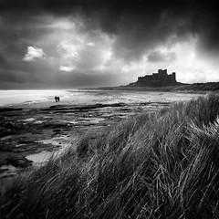 Historic Solitude (jasontheaker) Tags: ocean sea storm castle beach clouds walking surfing northumberland sanddunes embletonbay dunstanburghcastle bambrough bambroughcastle wwwjasontheakercom