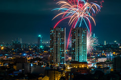 Fireworks and the City (Hendraxu) Tags: city building tower skyline architecture night skyscraper fire long exposure glow cityscape fireworks celebration celebrating nighstshoot
