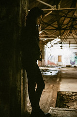 Portrait of Decay (e.m.alder) Tags: portrait people urban woman industry film girl smile female analog rural 35mm pose graffiti model nikon industrial kodak outdoor decay 135 fe portra nikonfe urbex halton c41 portra400 homedevelopment nikkor28200mmf3556afd canoscan9000f