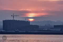 Tobacco and a lighter (alun.disley@ntlworld.com) Tags: water weather silhouette architecture liverpool sunrise cranes rivermersey portsandharbours
