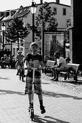The grass was greener ... (Giangaleazzo) Tags: life road street city boy monochrome grass wheel youth canon germany blackwhite strada child young cap eod wismar biancoenero germania citt lifeinthecity ragazzo ruote pattino giovane 40d
