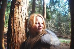 (nic lawrance) Tags: trees people sun nature girl smile face woodland shine cotswolds gloucestershire figure treebark llight