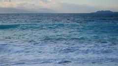 Wavy sunset. (Christos Andreou) Tags: mediterranean waves wind corinth greece coastline meditation melancholy videos winterlandscape loutraki cloudysunset sealandscape seasunset wildsea wavessunset cloudylandscape samsunggalaxykzoomsamples opticalzoomphotos