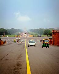 Shrouded in Monsoon Mist.. (~SilpaS GLH~) Tags: woman india photographer delhi capital monsoon median inthemiddle glasslighthues monsoonmist viewfromraisina indiangateafar delhiyellowandgreenautos theroaddivides