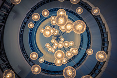 Globes of Light (DMontalbano) Tags: city travel blue light abstract building london dan architecture stairs spiral photography lights moody cityscape indoor stairwell staircase iconic brewer cecil montalbano 500px