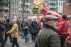 Chinese New Year (nl.djowie) Tags: china new city boy red food netherlands colors girl bike festival hall traffic bokeh famous year den chinese performance dragons hague nieuwjaar haag chinees