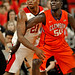 Wolfpack center BeeJay Anya (21) puts defensive pressure on Clemson's Sidy Djitte.