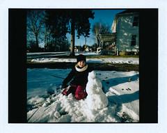 48 of 366 (johnlishamer.com) Tags: 2016 bataviail fp100c fujifilm jane lishamer polaroid project366 bluesky film home instantfilm johnlishamercom photoaday snow snowman sunlight sunny winter