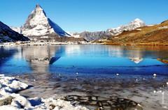 Reflexion (welenna) Tags: blue schnee autumn sky mountain lake snow mountains alps reflection water landscape switzerland see wasser view swiss berge matterhorn alpen eis reflexion wasserspiegel schwitzerland