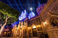 Disneyland: The Moon Rises Over Sleeping Beauty Castle (Jessie Chaisson) Tags: blue sleeping moon castle beauty jessie yellow night photography lights back nikon disneyland chaisson