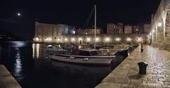 phosphorous on vagrant waters (cherryspicks) Tags: city light urban moon building water architecture night port harbor boat croatia historic dubrovnik unescoworldheritage adriatic