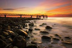 A new day begins (Anto Camacho) Tags: longexposure seascape valencia sunshine pier rocks mediterranean mediterraneo amanecer mediterraneansea largaexposicion marmediterraneo xilxes chilches valenciancommunity