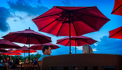 twilight UFOs (JimfromCanada) Tags: family blue red dinner umbrella restaurant twilight couple chat patio covert conversation bluehour dine