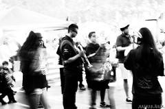 Musicians, half a second (esteveb) Tags: street monochrome streetphotography f22 carrer stabilized musics d7000 estabilitzat