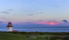 Light your house (Danny VB) Tags: ocean flowers light sunset sea sky lighthouse house canada grass clouds spring québec printemps gaspésie