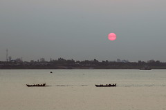 Sunrise on the Mekong river (pooly7) Tags: travel red sun travelling tourism water sunrise reflections river landscape boats boat asia cambodia outdoor transport delta phnompenh glowing riverfront mekong