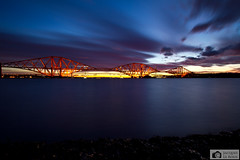 Bridge lighting up during sunset (Photographs by Jacques) Tags: blue light sunset red sea sky sun nature water beautiful beauty night clouds landscape scotland edinburgh pretty colours forth newbridge northqueensferry forthroadbridge roadbridge newforthroadbridge