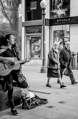Corner 19 (Luis Alvarez Marra) Tags: street camera city bw white black monochrome 35mm prime spain nikon guitar outdoor song candid snap catalonia soul luis moment alvarez tarragona collecting tog decisive marra streetsinger unpossed d7000 streettog