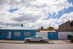 White Car in Punta Arenas, Patagonia, Chile (ChrisGoldNY) Tags: chrisgoldny chrisgoldphoto chrisgoldberg albumcover albumcovers bookcover bookcovers licensing forsale chile patagonia southamerica latinamerica chilean puntaarenas cloudy clouds cars white blue vehicles streets urban city challengewinners friendlychallenges