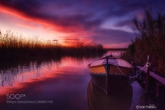 Boat and cloud (AleshaOleg) Tags: travel blue light sunset red sky sun lake colour reflection tourism water valencia beautiful clouds landscape atardecer landscapes boat spain ship fuji sundown lonely colourful exploration albufera