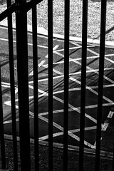 Lines? (Rocket_Man_81) Tags: shadow blackandwhite bw lines canon fence photography shadows geometry patterns sydney footpath blackandwhitephotography leadinglines