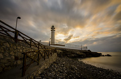 El Faro (J Fuentes) Tags: longexposure sea lighthouse clouds faro mar long exposure flickr amanecer nubes torrox mlaga largaexposicin