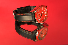 Red Time (Light Collector) Tags: reflection face hands watch strap stitching tabletop theflickrlounge saturdaythemered