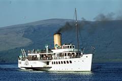 'Maid of the Loch' (closer) nears Luss. May'80. (David Christie 14) Tags: lochlomond luss maidoftheloch