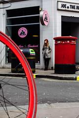 London 10x15 V04 (LondonFrog) Tags: street uk red england london girl bike wheel shop composition mailbox pavement soho streetphotography letterbox shopsign centrallondon 2016