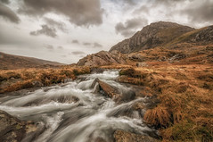 Tryfan (einir.leigh) Tags: uk winter sky orange snow mountains colour water rain wales clouds river walking landscape outdoors waterfall nikon rocks stream waves seasons britain outdoor lakes welsh snowdonia rugged gwynedd northwales ogwen ogwenvalley