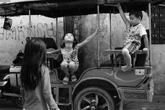 Kids  Phnom Penh (Jules en Asie) Tags: world street travel boy people blackandwhite white playing black girl kids children asian julien kid asia cambodge cambodia cambodian khmer child little tuktuk asie phnom nationalgeographic penh asiatique reflectionsoflife lovelyphotos jules1405 cambodgien unseenasia earthasia mailler