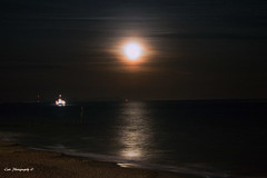 Moon rising from Boscombe pier (cat.preen) Tags: uk moon seascape beach night reflections rising lights coast boat nikon elements dorset capture boscombe