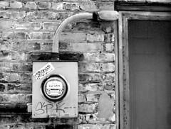 The Meter Is Running (Bronica John) Tags: old winter blackandwhite bw white black electric mi self graffiti town fuji kodak michigan bricks bronica photowalk neopan 100 meter oldtown developed electricmeter acros xtol saginaw etrsi fujineopanacros100 saginawmichigan saginawmi kodakxtol film:brand=fuji film:iso=100 oldtownsaginaw developer:brand=kodak developer:name=kodakxtol film:name=fujineopanacros100 saginawphotowalk filmdev:recipe=10727
