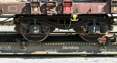 0020_2005_06_23_sterreich_Jenbach_Zillertalbahn_Rollbock_Radsicherung (ruhrpott.sprinter) Tags: railroad 3 train germany logo deutschland austria tirol sterreich diesel outdoor d no 14 eisenbahn rail zug 11 db cargo nrw 111 passenger 12 alpen 13 fret ruhrgebiet freight vt locomotives kessel zillertal dampflok lokomotive lok sprinter ruhrpott gter sonderzug lokschuppen svarowski schmalspur 4780 reisezug zillertalbahn drehgestelle ellok kohlebansen rollbock schwerlastwagen