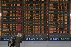 where's my flight, what the heck (micmol ) Tags: city trip travel woman paris france horizontal airport day transport indoor traveller journey transportation backpack destination adults fr departures charlesdegaulle timetable cdg traveler caucasian lookingfor