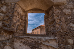 View through the wall (Sorin Popovich) Tags: france window stone wall landscape outdoors europe day cityscape nopeople medieval roofs provence roofscape lesbauxdeprovence bauxdeprovence fortifiedwall lookingthroughwindow