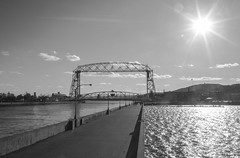 Civil Engineer Admiration (avisualstudy) Tags: blackandwhite bw monochrome sunshine minnesota midwest bridges structure sunrays duluth civilengineering northshare