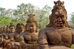 Demon statues along the road over the moat to the Southern Gate of the ancient city of Angkor Thom near Siem Reap, Cambodia (UweBKK ( 77 on )) Tags: city trees history ancient gate asia cambodia kambodscha sony south statues southern siem reap thom demon historical southeast alpha dslr angkor moat 77 slt demons