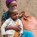 Genet Tesfaye, 10 and her two year old brother Samuel Tesfaye pose for a photo in their house