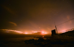 Oil Lamp (Kojaniemi) Tags: mist reflection reed rock fog night straw flame smokestack shore bigdipper seasmoke oilrefinery arcticsteam