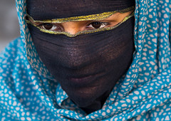 bandari woman with face covered at the panjshambe bazar thursday market, Hormozgan, Minab, Iran (Eric Lafforgue) Tags: people woman beautiful beauty face fashion horizontal closeup scarf religious outdoors photography eyes women asia veiled veil mask iran market muslim islam religion hijab culture persia headshot womenonly hidden covered iranian bazaar adultsonly cultural oneperson traditionaldress customs middleeastern sunni 20sadult youngadultwoman balouch hormozgan onewomanonly  bandari  1people  iro thursdaymarket  minab colourpicture  panjshambe panjshambebazar boregheh iran034i2857