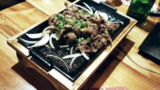 You're Sizzlin' Baby: soya sauce and mirin marinated pork shoulder over a sizzling teppan plate