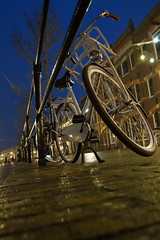Typical parked Dutch bicycle (Dannis van der Heiden) Tags: rain bicycle architecture dark evening parked raining locked notripod amersfoort fiets damesfiets hiiso