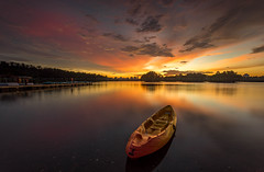 Sunset at Taman Rekreasi Air Wetland, Putrajaya (HakiimMislam) Tags: longexposure bridge sunset red sky cloud sun water yellow canon boat exposure ray outdoor dusk sony wideangle filter lee malaysia nd serene putrajaya hdr 1740 wetland gnd sonya7 raymaster