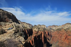 Dizzying (Brandi Bonde) Tags: park blue winter red sky mountain rock stone clouds utah nationalpark hike zionnationalpark bluff